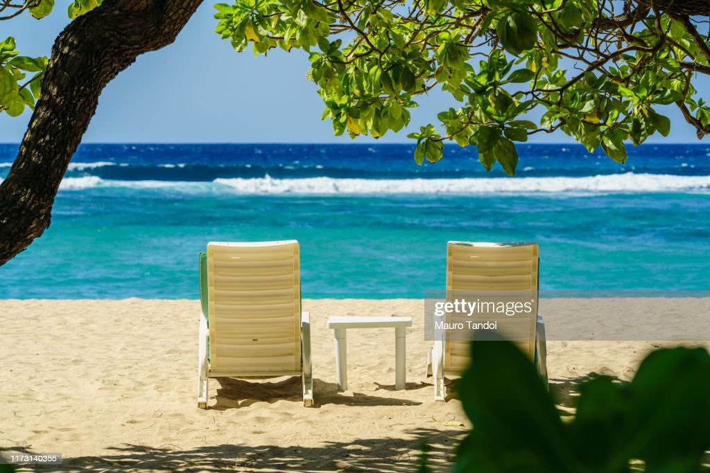 Two deckchairs on the tropical beach of Nusa Dua : Foto stock