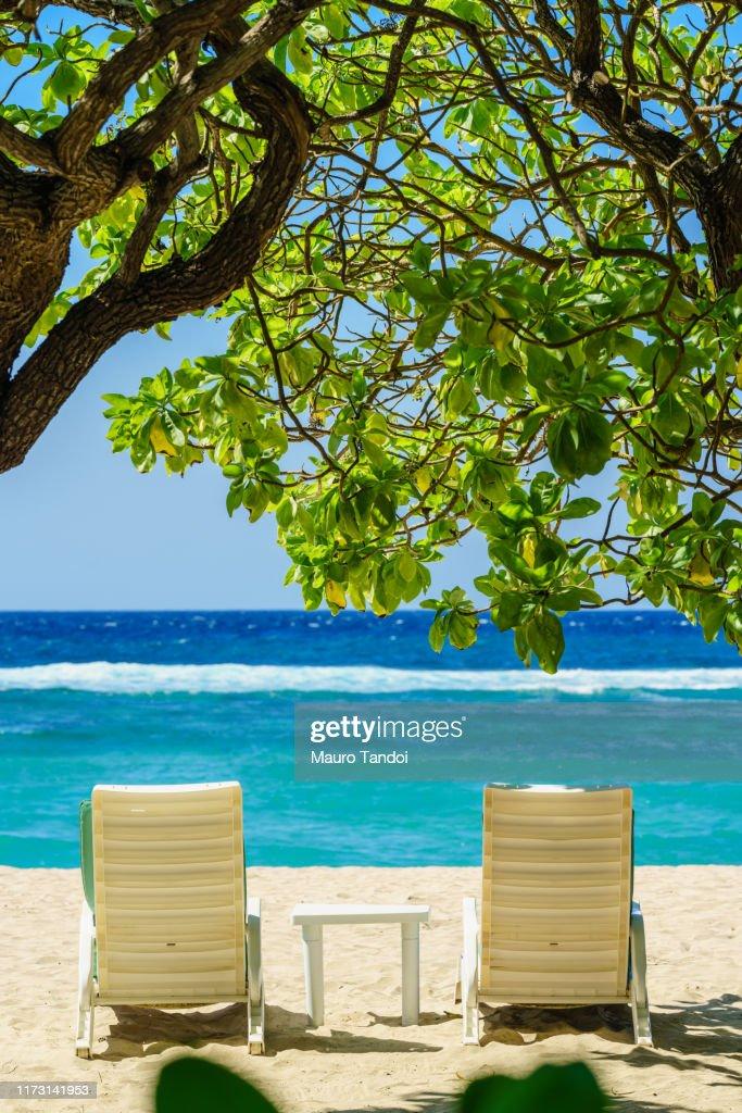 Two deckchairs on the tropical beach of Nusa Dua : Foto stock