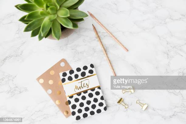 two decorative polka dot notebooks with pencils - polka dot stock pictures, royalty-free photos & images