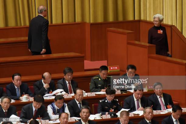 Two delagates exit The Great Hall of People during the opening session of the 13th National People's Congress on March 5, 2018 in Beijing, China.