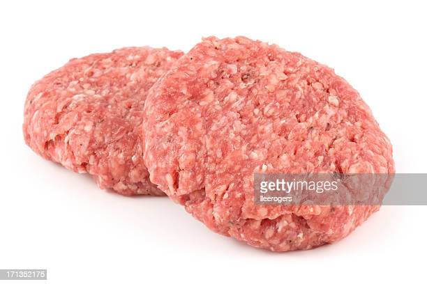 two delicious angus beef burgers isolated on a white background - raw food stock pictures, royalty-free photos & images