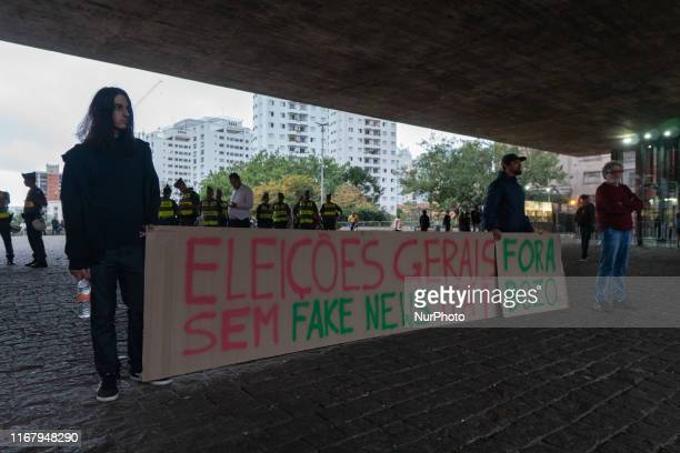 Two demonstrator show a paper that reads general elections without fake news nowquot and quotout Bozoquot during protest against the President Jair...