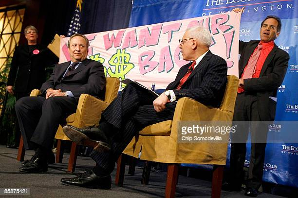 Two demonstrators from Code Pink For Peace interrupt an interview between Lawrence Summers , the Director of President Barack Obama's National...
