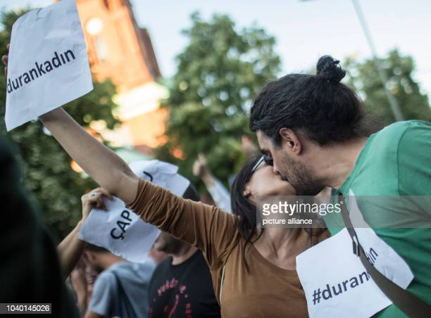 Two demonstrators kiss each other as a sign of protest against the planned ban on kissing in public in Turkey during a protest rally at the Fête de...