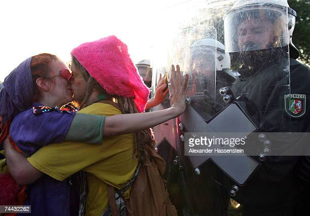 Two demonstrators kiss in front of riot police on June 07 2007 near Hinter Bollhagen close to Heiligendamm Germany Thousands of G8 opponents continue...