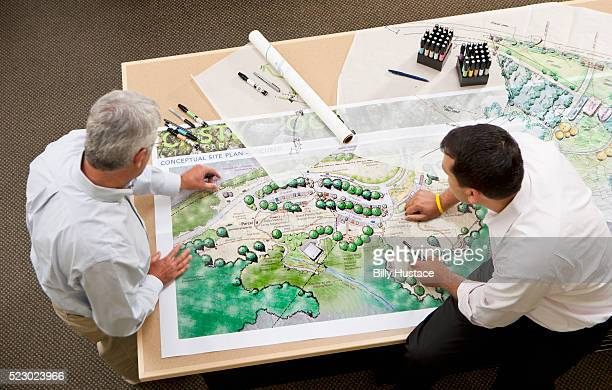 two design professionals at work in an office - landscaped stock pictures, royalty-free photos & images