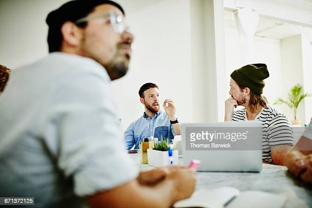 Two designers in discussion during meeting