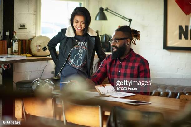 Two designers in studio.