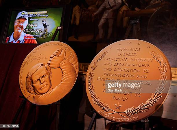 Two detail photographs of Jack Nicklaus' Congressional Gold Medal are on display during a special ceremony in the Rotunda of the Capitol Building on...