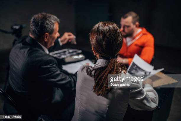 two detectives interrogating a prisoner - police station stock pictures, royalty-free photos & images