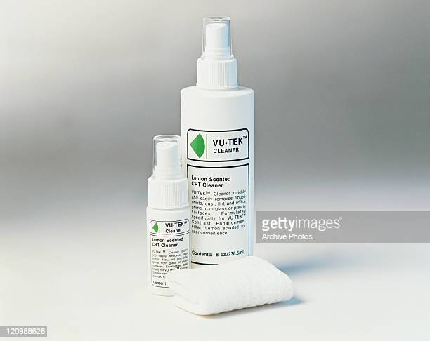 Two different spray bottles on white background