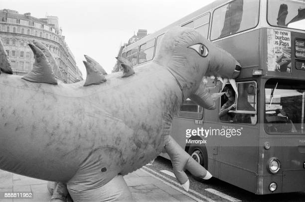 Two dinosaurs as high as a double decker bus fight each other in London's Trafalgar Square The event is to publicise the Boys and Girls Exhibition...