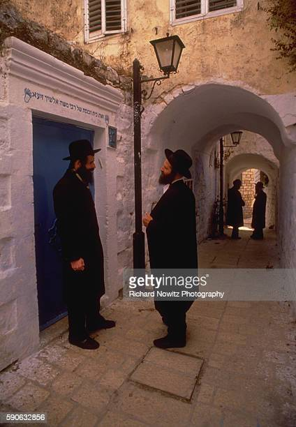 Two discussions in an alley in the mystical Jewish city of Sefad where the Kabbala Judaism's foremost mystical text was written in the 2nd Century by...