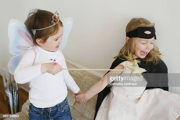Two disguides children playing together