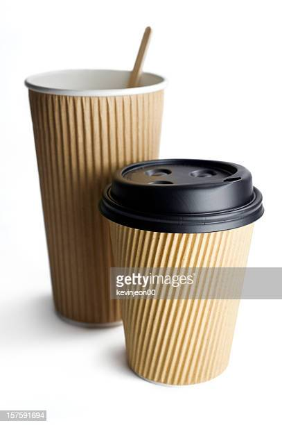 Two disposable take-out coffee cups isolated on white