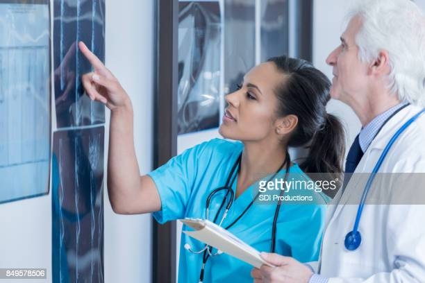 Two diverse radiologists review x-ray images