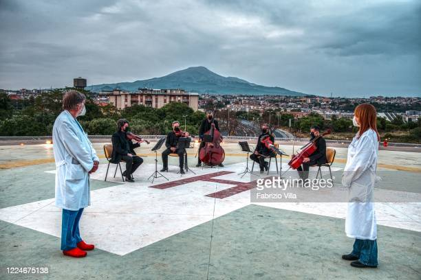 Two doctors attend on behalf of their colleagues the performance of the musicians of the Sikelikos quintet formed by orchestra professors of the...