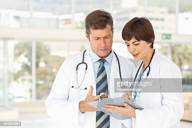 Two Doctors Consulting One Another