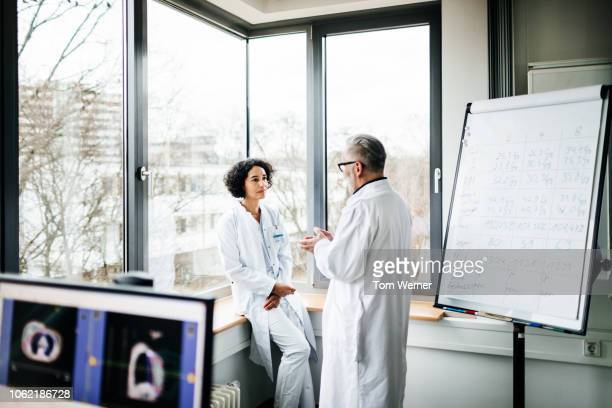 two doctors discussing test results in the lab - medicinsk forskning bildbanksfoton och bilder