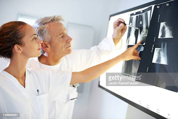 Two doctors discussing x-ray results