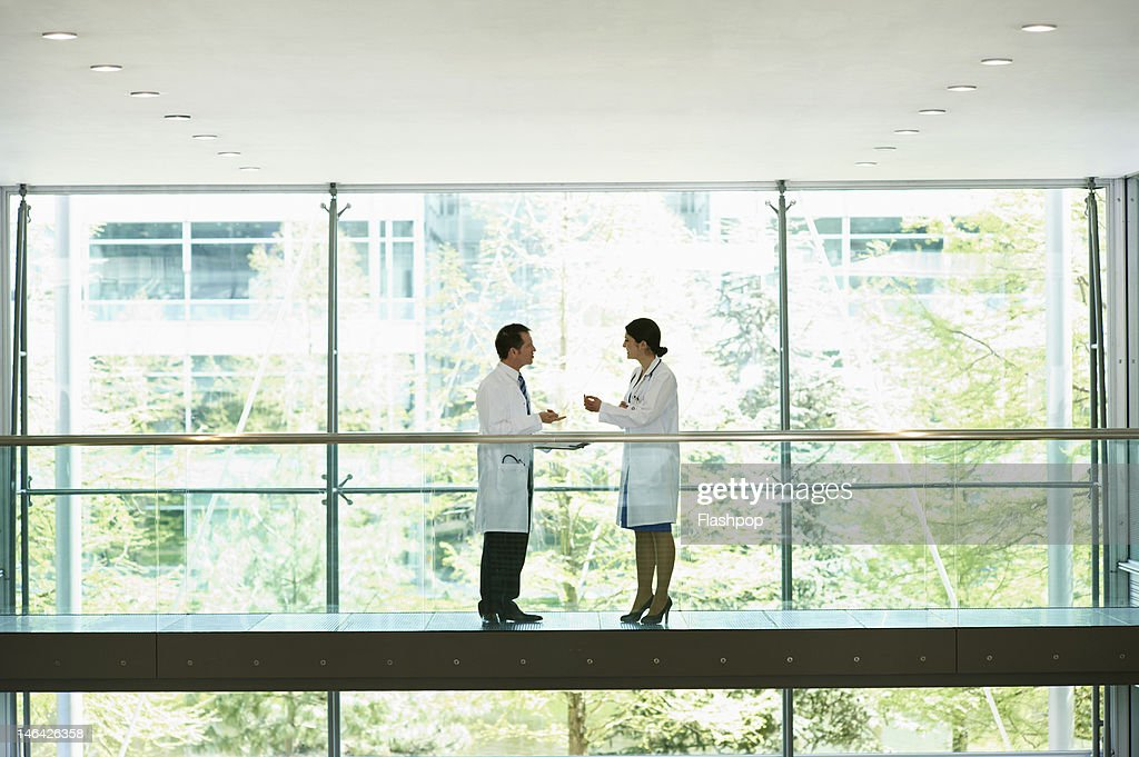 Two doctors having an informal meeting : Stock Photo