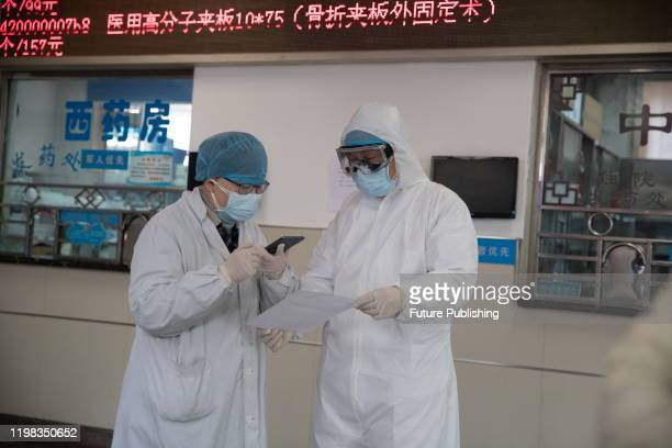 WUHAN CHINA FEBRUARY 1 2020 Two doctors talk Zhuoer Yangtze River emergency hospital the eighth hospital of Wuhan Wuhan City Hubei Province China...