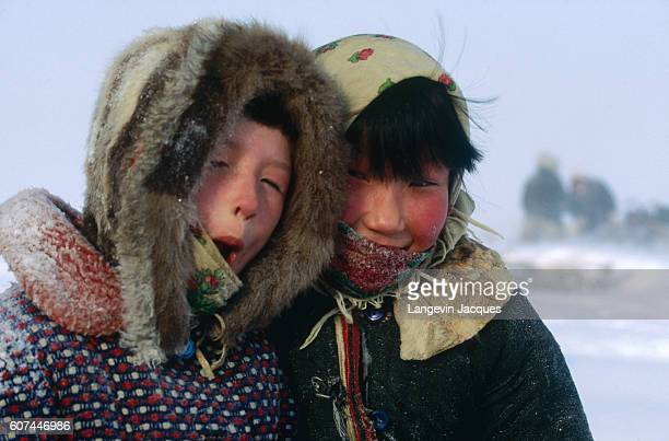 Two Dolgan children welcome a hunting party back to their camp near the village of Syndassko Russia The Dolgans traditionally a nomadic people who...