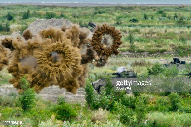 Two domestically-made armoured vehicles launch smoke grenades during the annual Han Kuang military drills in Taichung on July 16, 2020. - The...