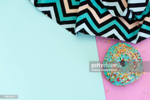two donuts turquoise color with white stripes isolated on white background. top view. - white stripes stock pictures, royalty-free photos & images