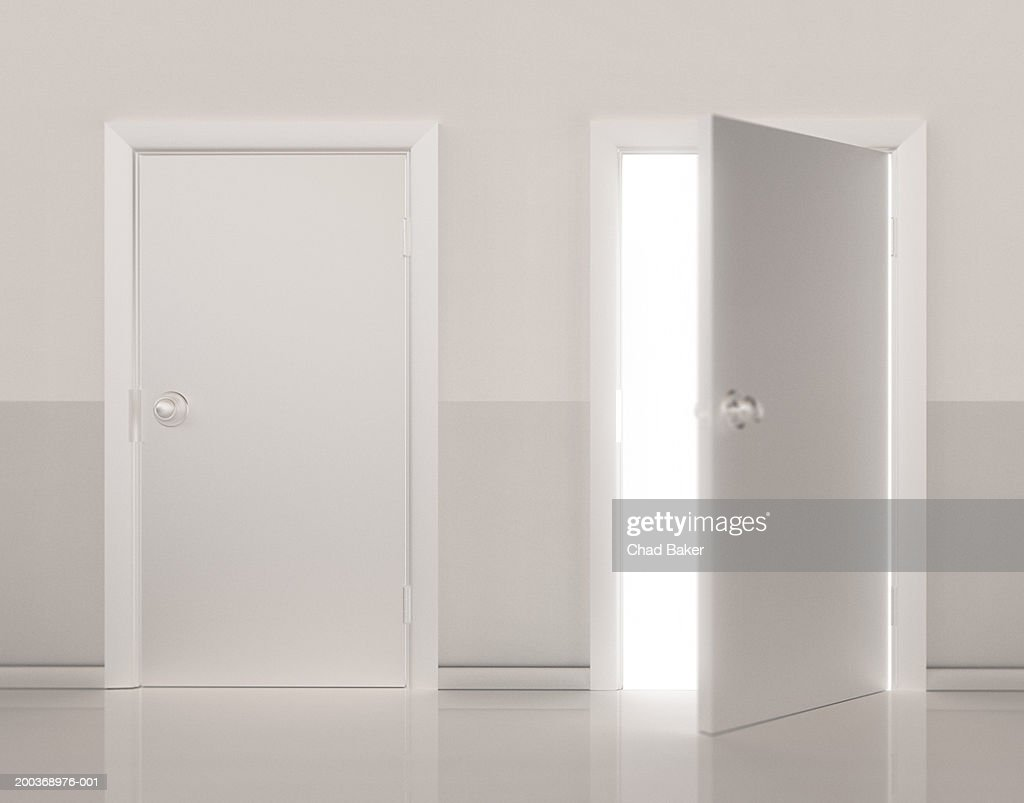 Two Doors Side By Side One Door Open Stock Photo | Getty Images