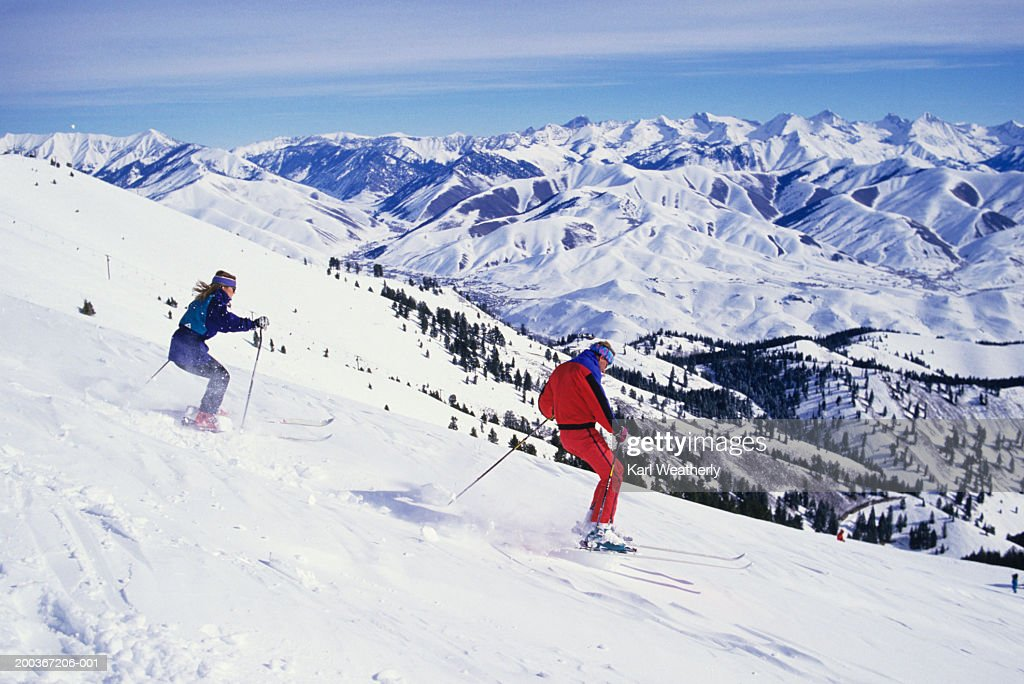 Two downhill skiers on slope, Sun Valley, Idaho, USA : Stock Photo