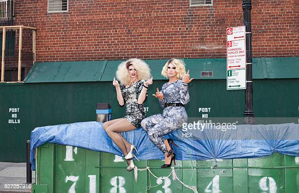 Two drag queens giving the finger