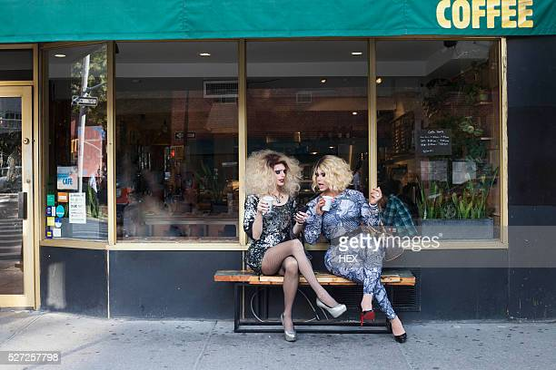 two drag queens sitting drinking coffee - transvestite stock photos and pictures