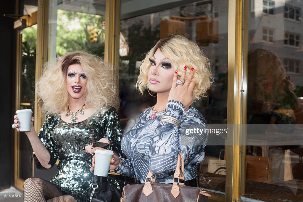 Two drag queens sitting drinking coffee : Stock Photo