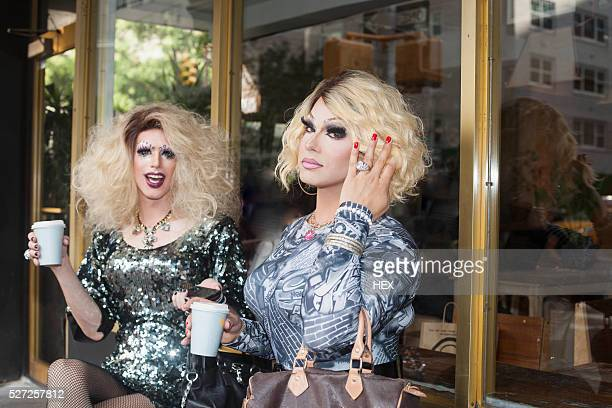 Two drag queens sitting drinking coffee
