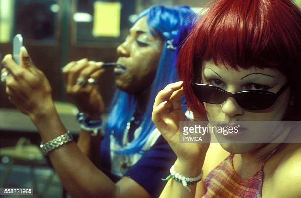 Two drag queens / transvestites in Castro San Francisco one puting on Makeup USA 2002