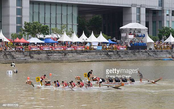 CONTENT] Two dragon boats approach the finish line during a men's 12crew race at the 31st Singapore River Regatta 2013 held at the Singapore River
