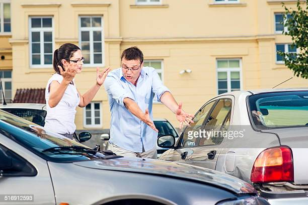 two drivers arguing after traffic accident - blame stock pictures, royalty-free photos & images