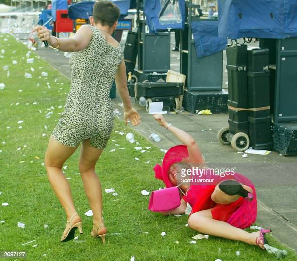 Two drunk race-goers make their way home after the last race of the third day of the Royal Ascot horse racing week June 19, 2003 in Ascot, England....