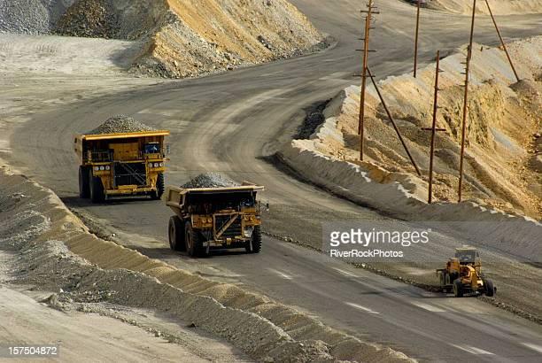 Two dump trucks at a mine in Utah
