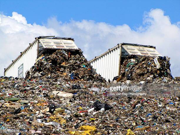 Two dump trucks at landfill