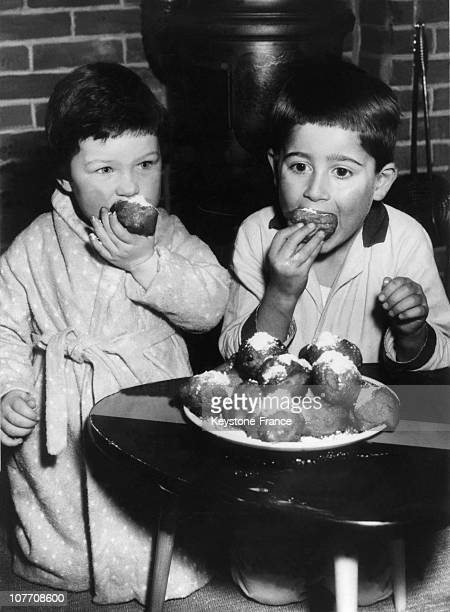 Two Dutch Children Enjoyed Donuts Oil On January 02Nd 1959