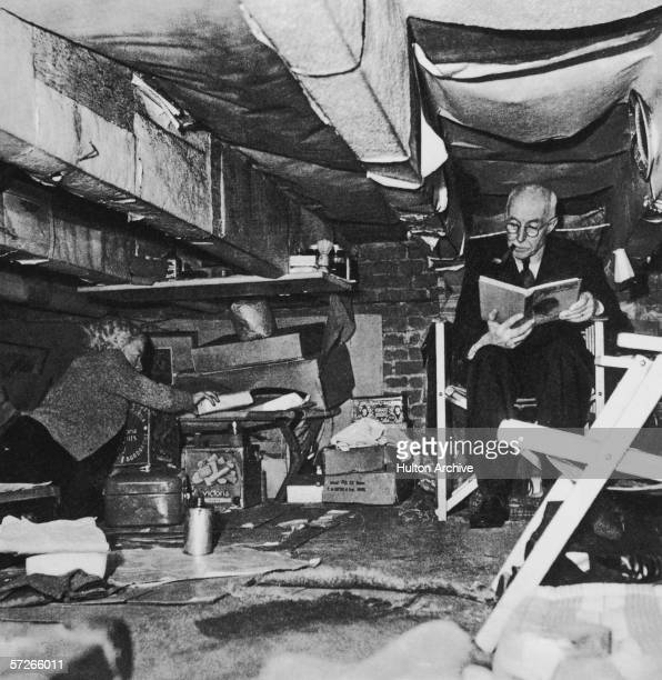 Two Dutch Jews living in a tiny cellar during World War II circa 1945 The room is too small for them to stand upright and the only person who knows...