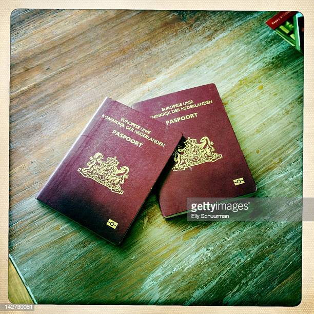 two dutch passports - dutch culture stock photos and pictures