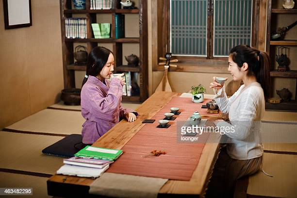 Two east asian girl showing Tea Ceremony