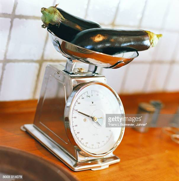 Two Eggplants on Weight Scales