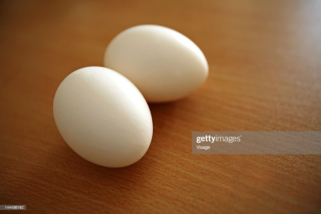 Two eggs on a table : Stock Photo