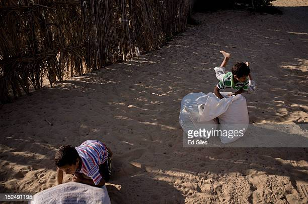 Two Egyptian bedouin play in the village of Al Muqattah, in Egypt's restive North Sinai region, September 20, 2012. The village of Al Muqattah lies...