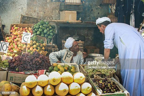 Two Egyptian men talking at a vendor's street stall Aswan Egypt Middle East Egypt's streets are congested with street vendors who often disrupt roads...