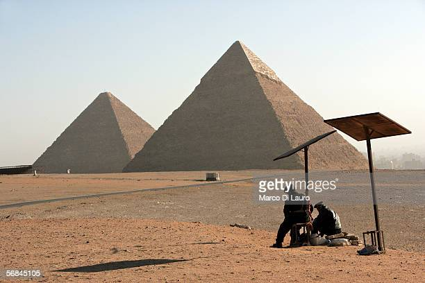 CAIRO EGYPT FEBRUARY 9 Two Egyptian Tourist Police Officers guard the area of the Great Pyramides Chephren and Mycerinus seen on the background on...